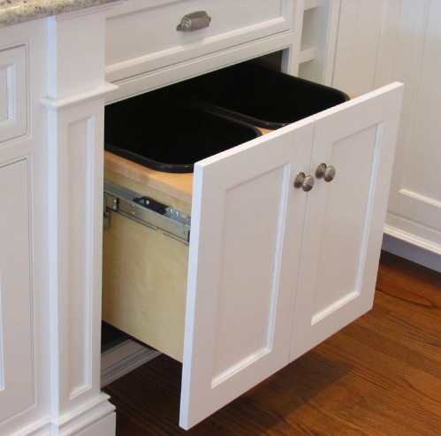 Hidden trash barrels in kitchen
